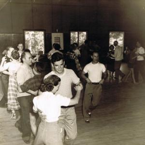 Ralph Piper teaching a Round dance at American square school 1950.jpg
